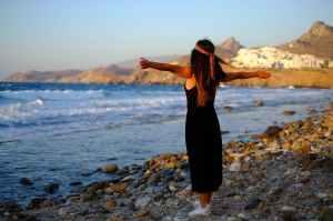 women s black long sleeveless dress